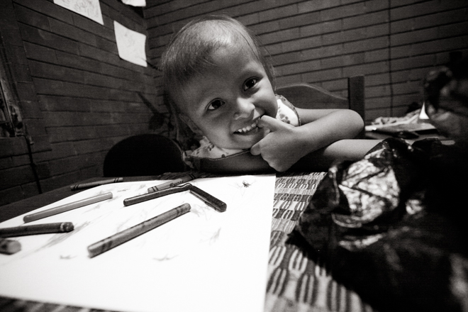 Little girl, coloring at a table.