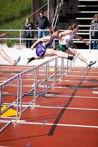 Female runners on the high hurdles.