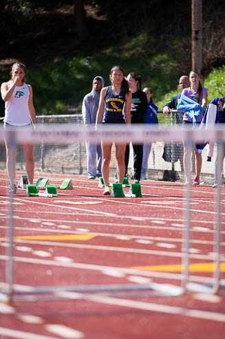 Female runner from Bainbridge Island getting ready for the high hurdles.