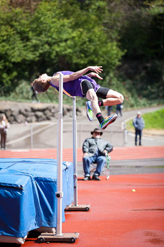 Male high jumper from Puyallup High School coming over the bar.