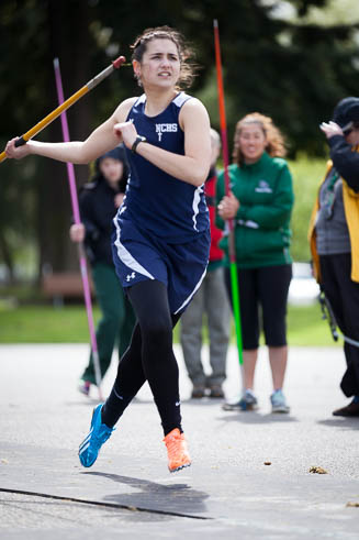 Female javelin thrower from Northwest Christian High School in mid throw.