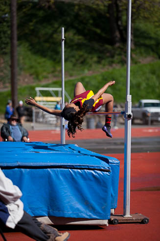 Female high jumper from Mt Tahoma HS coming over the bar.