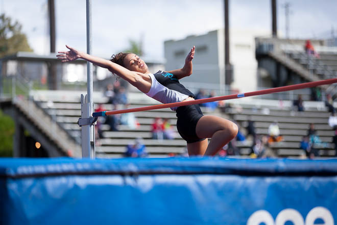Female high jumper from Spanaway Lakes HS stretched out over the bar.