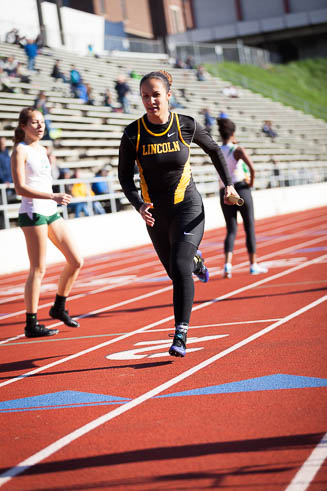 Female Lincoln HS runner in the 4x400 race.